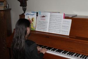 Laura at Dad's piano